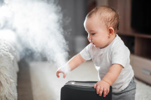 kid with humidifier